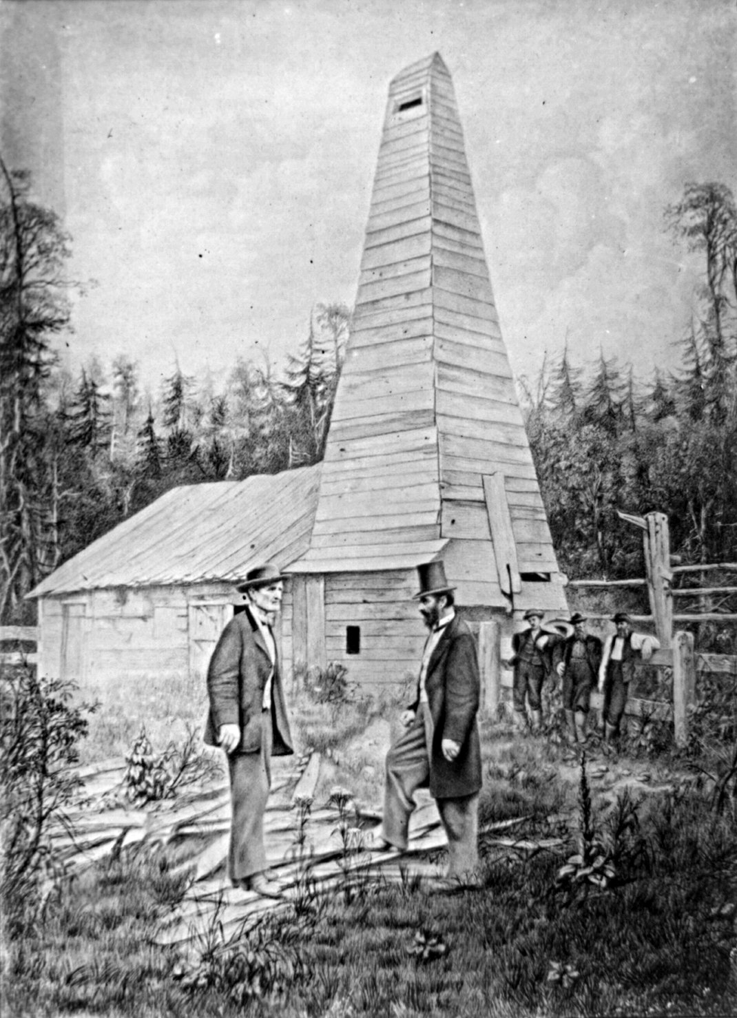 Edwin Drake (right) and his first commerce oil field (building at the back)